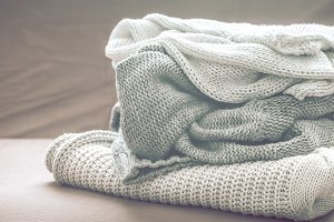 knitted sweaters on the couch