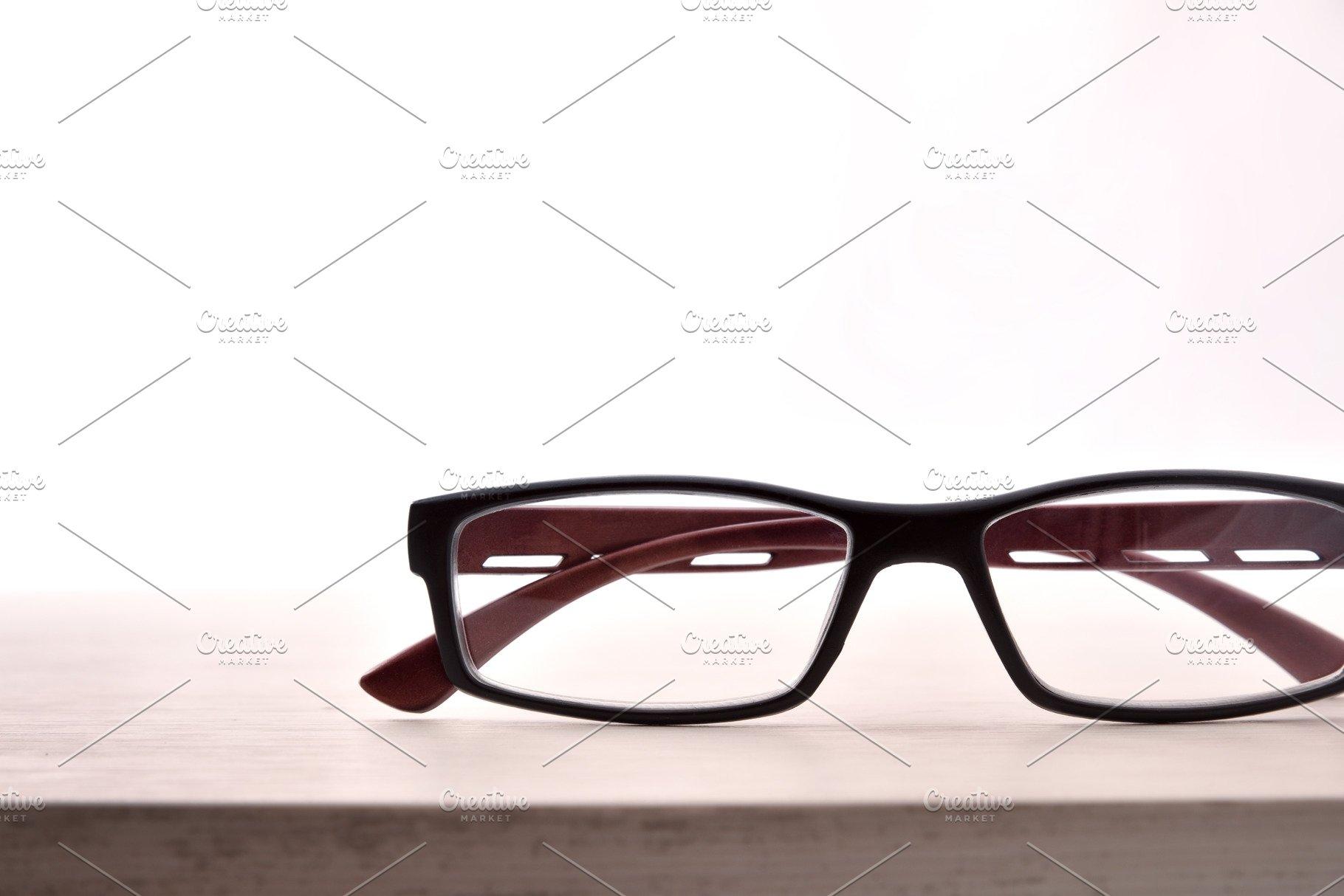 79b75155a82a Eyewear on table white background ~ Arts & Entertainment Photos ~ Creative  Market