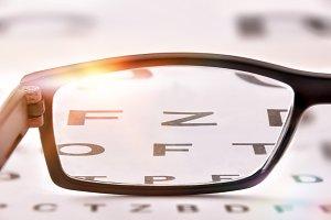 Glasses on alphabet letter  close up