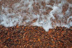 sea pebbles covered with soothing wa