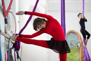 Elegant gymnast doing stretching in