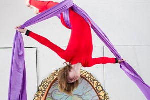 Female air gymnast in a red