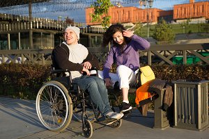 Happy couple - disabled man in