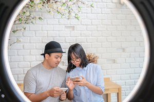 Asian Young Couple using the smart m