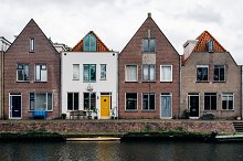 Scenic view of canal and row houses by  in Transportation