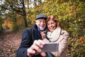 Senior couple in love in an autumn