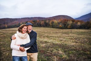 Senior couple hugging in an autumn
