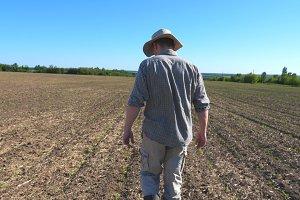 Unrecognizable male farmer going on