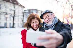Senior couple with smartphone on a
