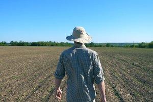 Unrecognizable young male farmer in