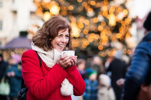 Senior woman on an outdoor Christmas