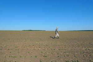 Profile of young male farmer walking