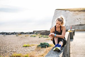Young sporty woman runner resting