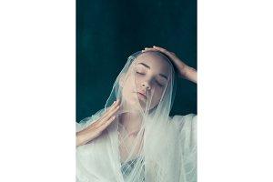 Beautiful bride looking over her