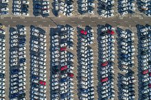 Cars parked neatly, in view of drone
