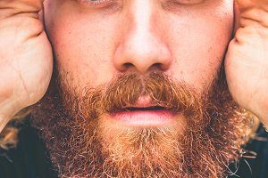 Close up of a serious man with beard