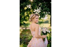 portrait of bride in pink dress