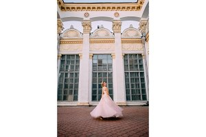 portrait of young bride near columns