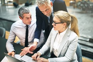 Three mature businesspeople discussi