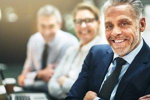 Smiling mature businessman sitting w