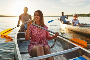 Young woman canoeing with friends on