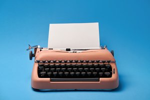Retro typewriter coral color in