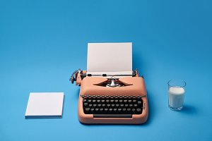 Composition with typewriter, book