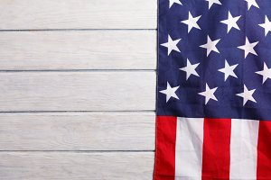 American flag close up on wood desk
