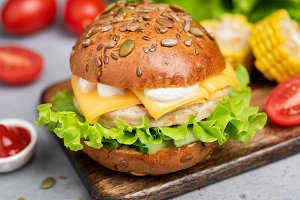 Chicken burger with cheese, lettuce