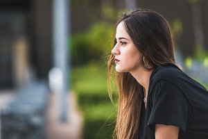Beautiful young woman thinking in th
