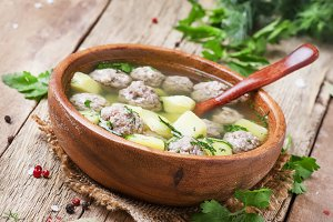 Homemade soup with turkey meatballs,
