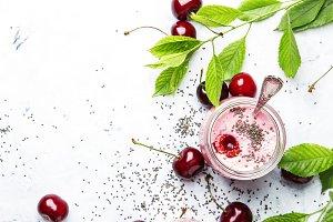 Pink cherry milkshake with berry and