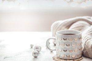 cozy winter composition with a cup