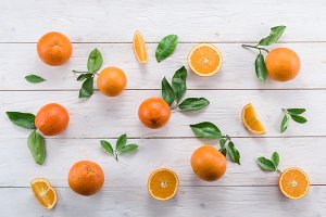 Ripe oranges on the white wooden tab