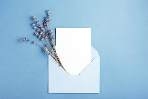 Mockup with card in blue envelope.