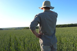 Male farmer standing in field and