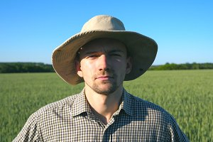 Portrait of confident farmer in hat