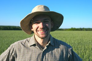 Close up of happy young farmer in