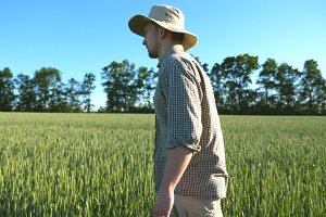 Side view of young male farmer in