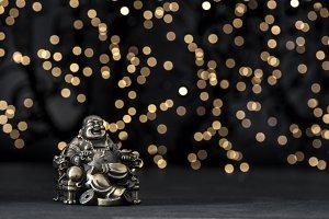 Golden buddha blurred background Wea