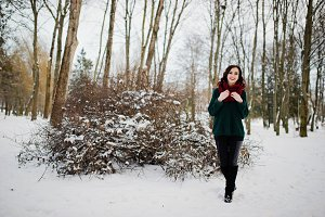 Brunette girl in green sweater and r