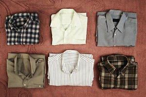 Benigno shirts on antique bedspread