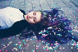 Cool woman surrounded by confetti
