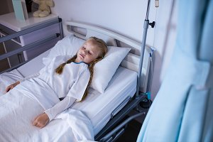 Patient relaxing on bed in ward