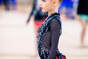 Beautiful little active gymnast girl