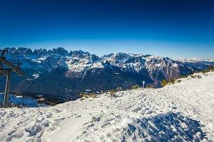 Alpine mountain range view with ski