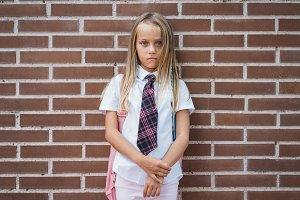 Beautiful cute schoolgirl posing in