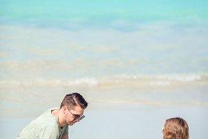 Father and little kid enjoying beach