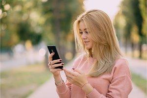 girl is using smartphone on street