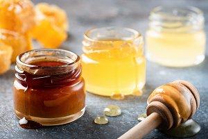 Honey in jar with wood honey dipper
